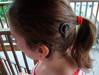 Photo of child with cochlear implant