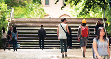 students walking through the campus